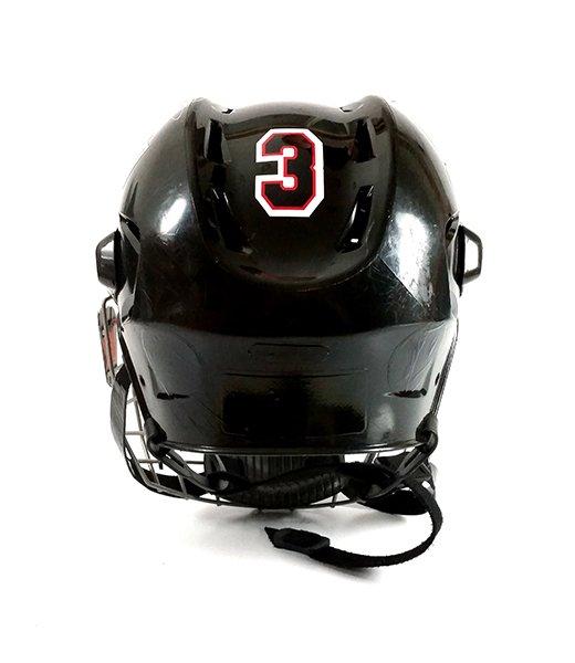 Black hockey helmet with athlete number decal.
